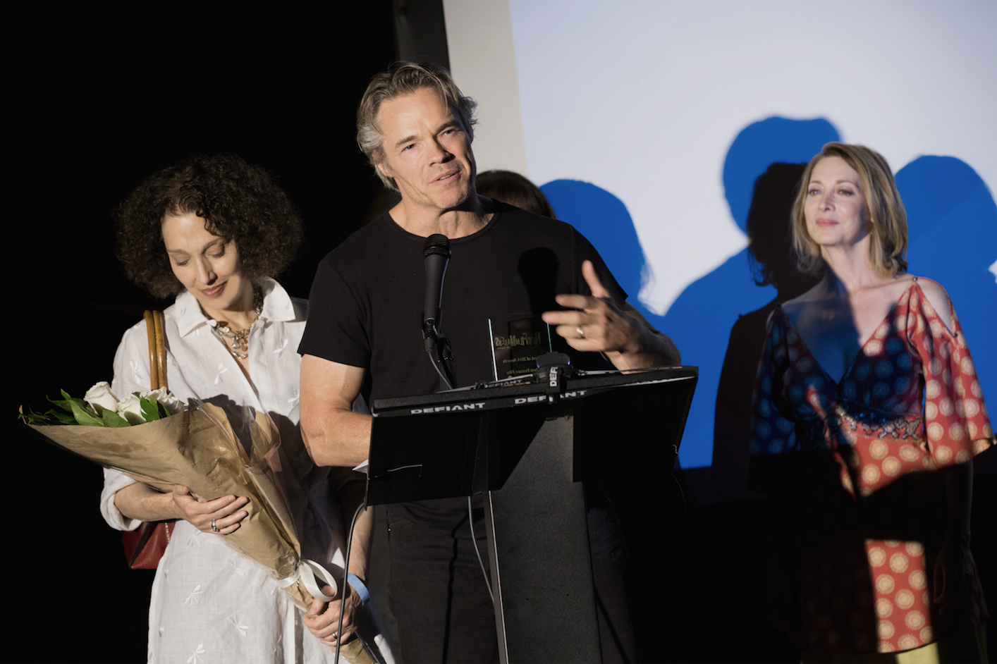 Writer-director Tjardus Greidanus wins for Best Feature at NFMLA's 2014 Best of Awards.  Producer Laura Davis on the left; presenter Sharon Lawrence on the right.